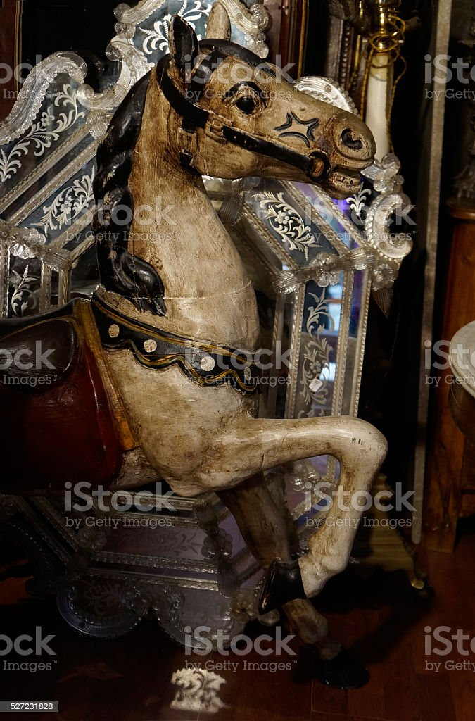 Old carousel horse on Paris flea market stock photo