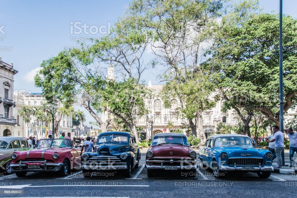 Old cars parked by Parque Central in Havana, Cuba - April 2017 stock photo