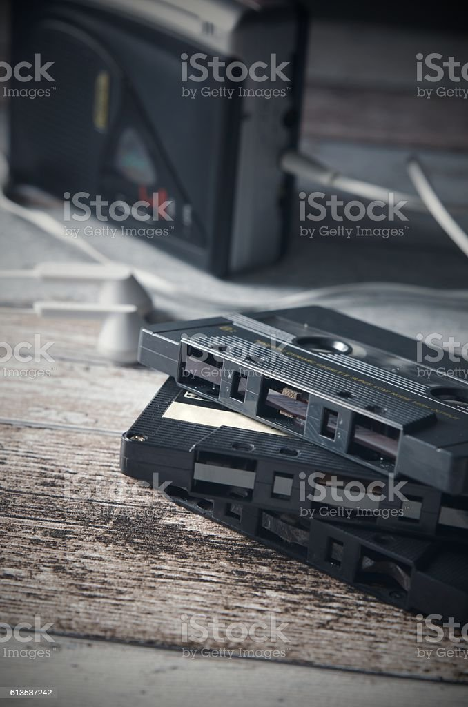Old casette tape player and recorder with earphones stock photo