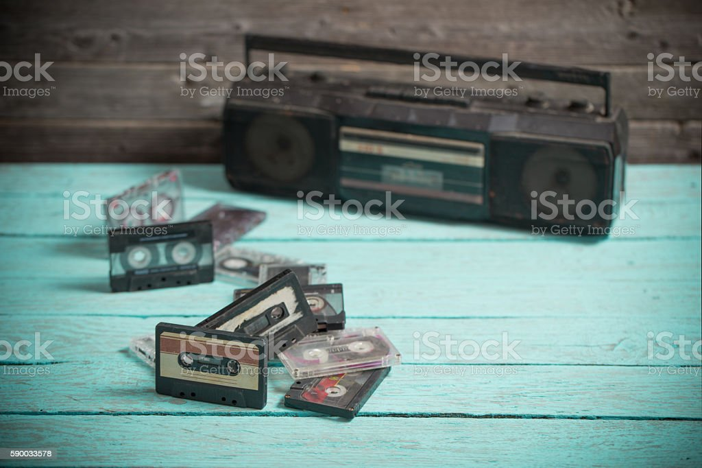 old cassette tape and player on the wood background stock photo