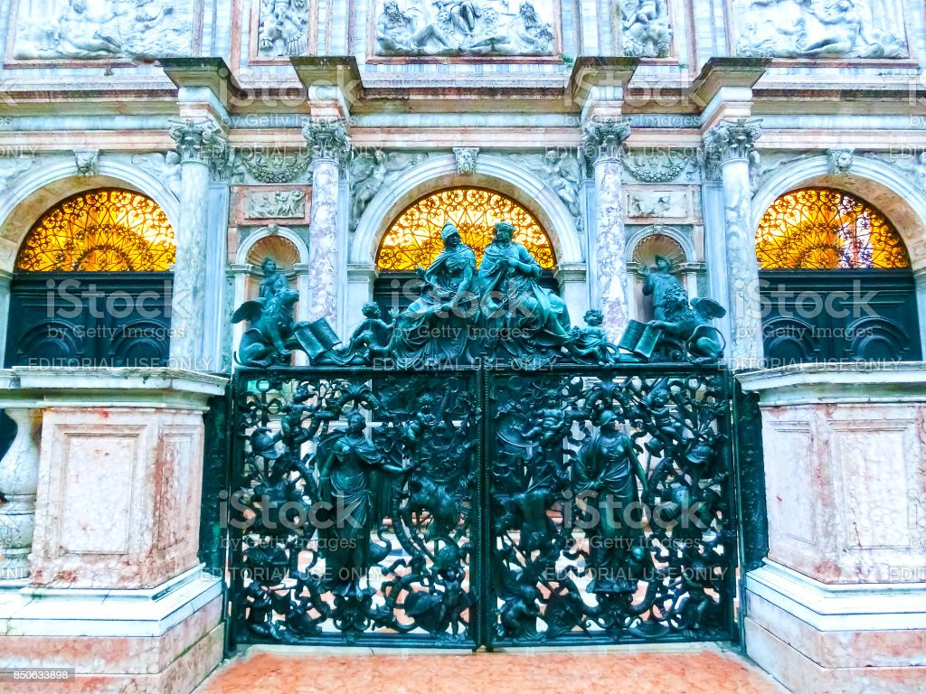 Venice, Italy - May 04, 2017: old cast-iron sculptural gates near Bell tower of St. Mark's Basilica in Venice stock photo