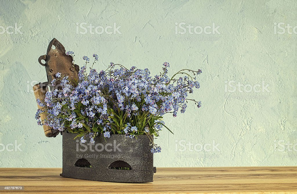 Old cast-iron with blue flowers royalty-free stock photo