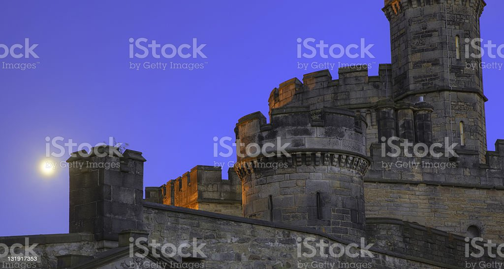 Old Castle with Towers in Moonlight royalty-free stock photo