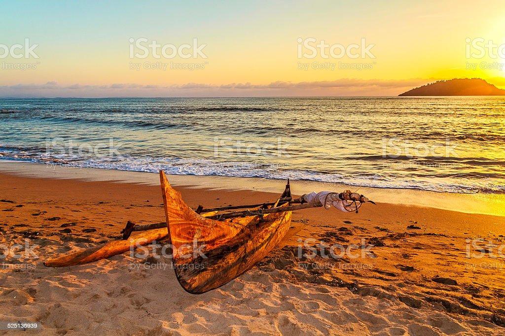 Old Catamaran on the Beach at Nosy Be Island stock photo