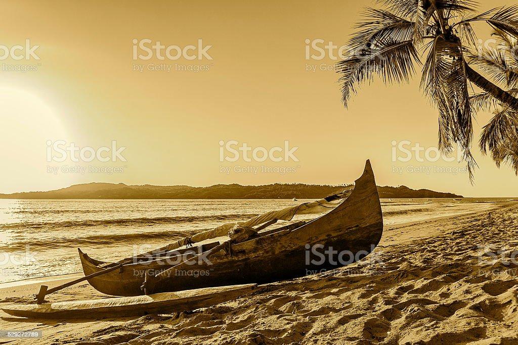 Old Catamaran on the Beach in Madagascar. stock photo