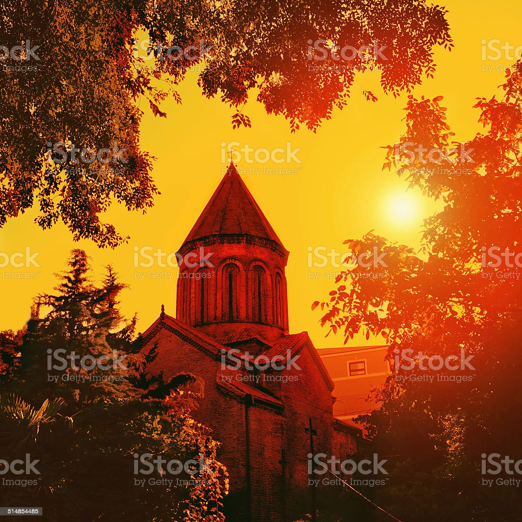 Old cathedral at sunset stock photo