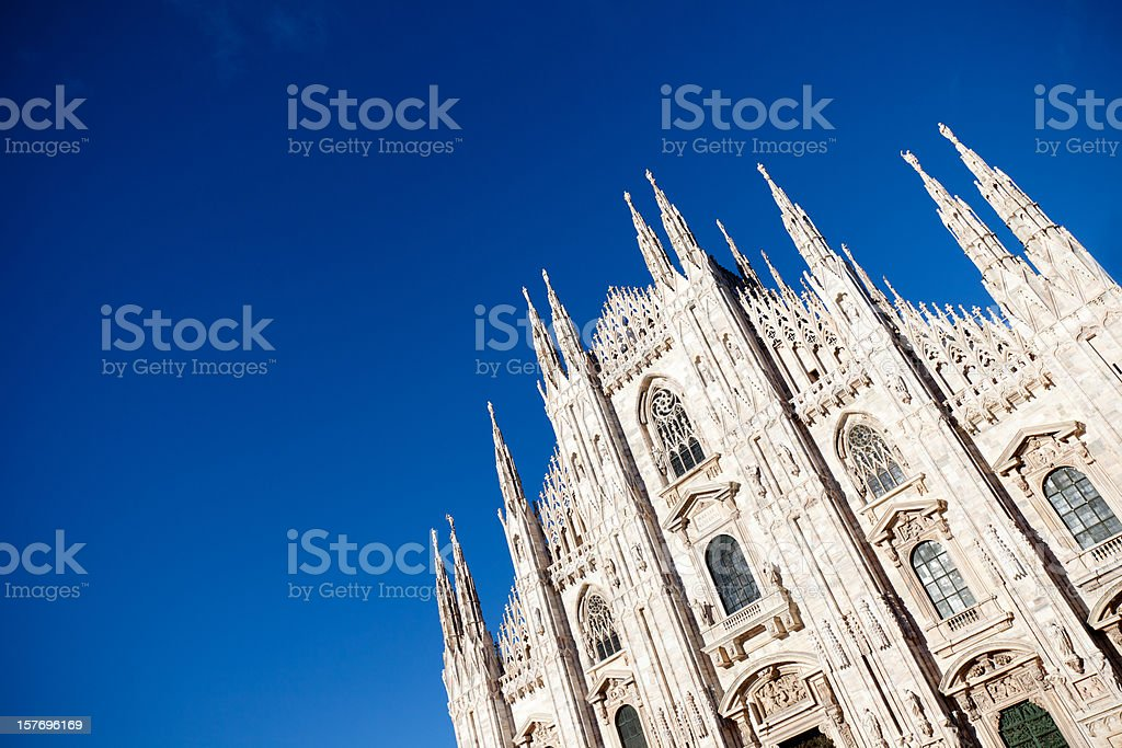 Old cathedral in Milan from low angle on a clear sunny day royalty-free stock photo