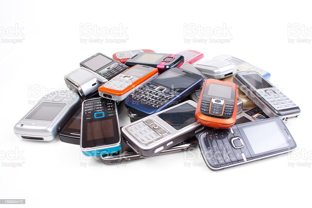 Old cell phones on a white background  royalty-free stock photo
