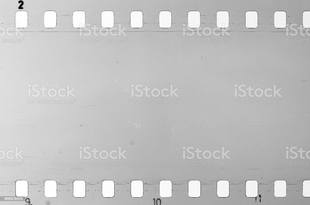 Old celluloid film with dust and scratches stock photo