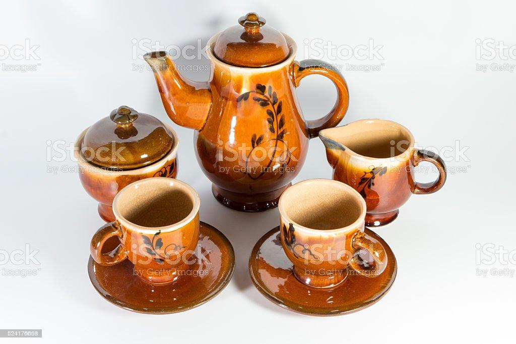 old ceramic tea set on white background stock photo