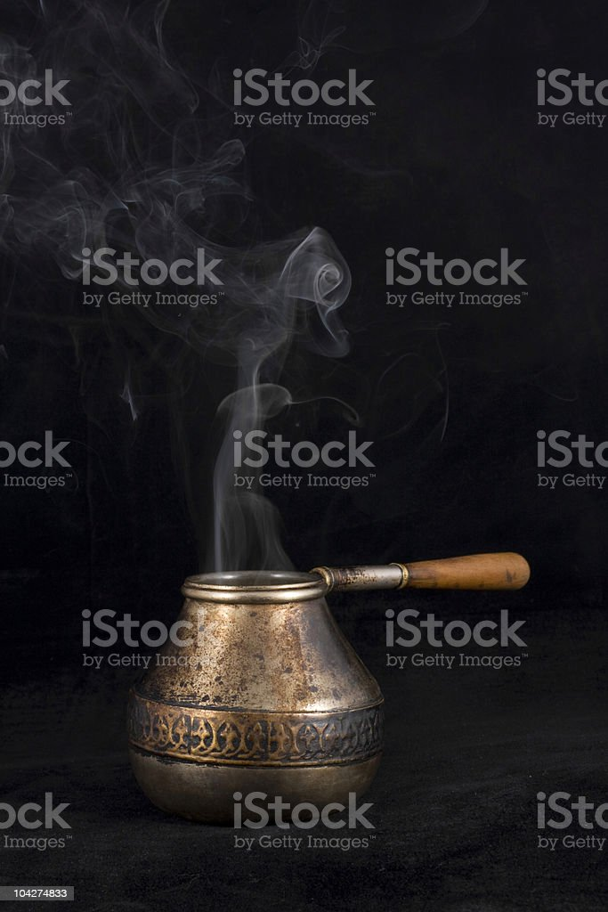 Old cezve with smoke royalty-free stock photo