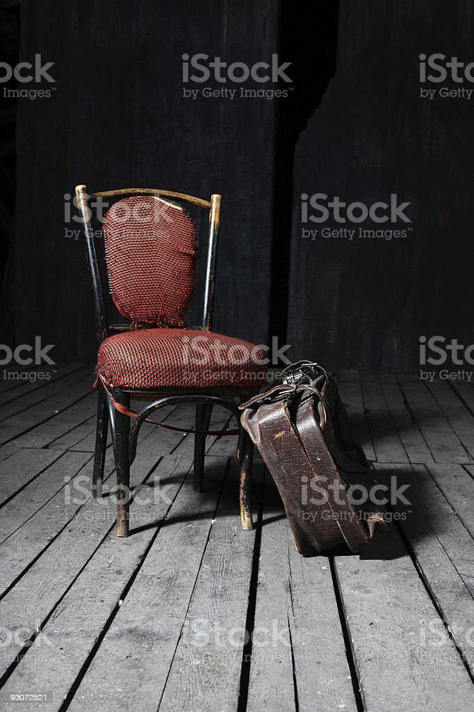 Old chair and suitcase royalty-free stock photo