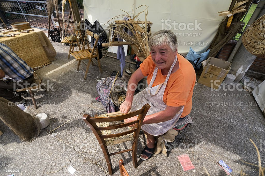 Old chair mender woman stock photo