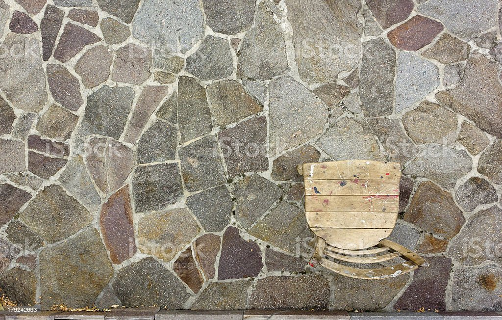Old Chair on Porphyry Paving royalty-free stock photo