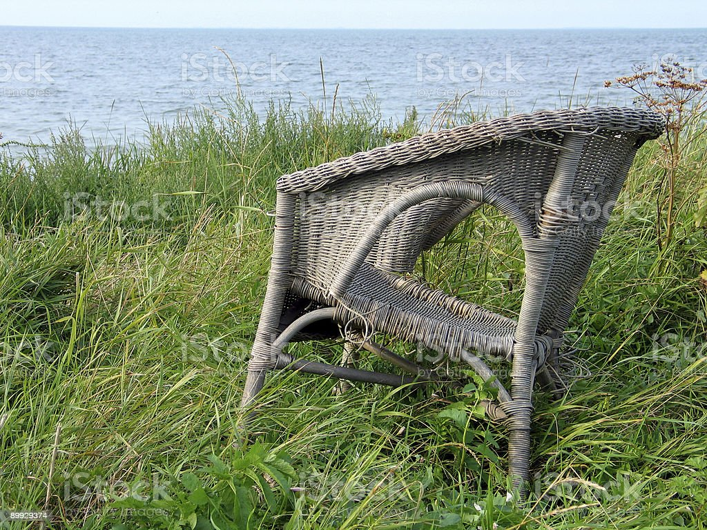 Old chair on the beach royalty-free stock photo