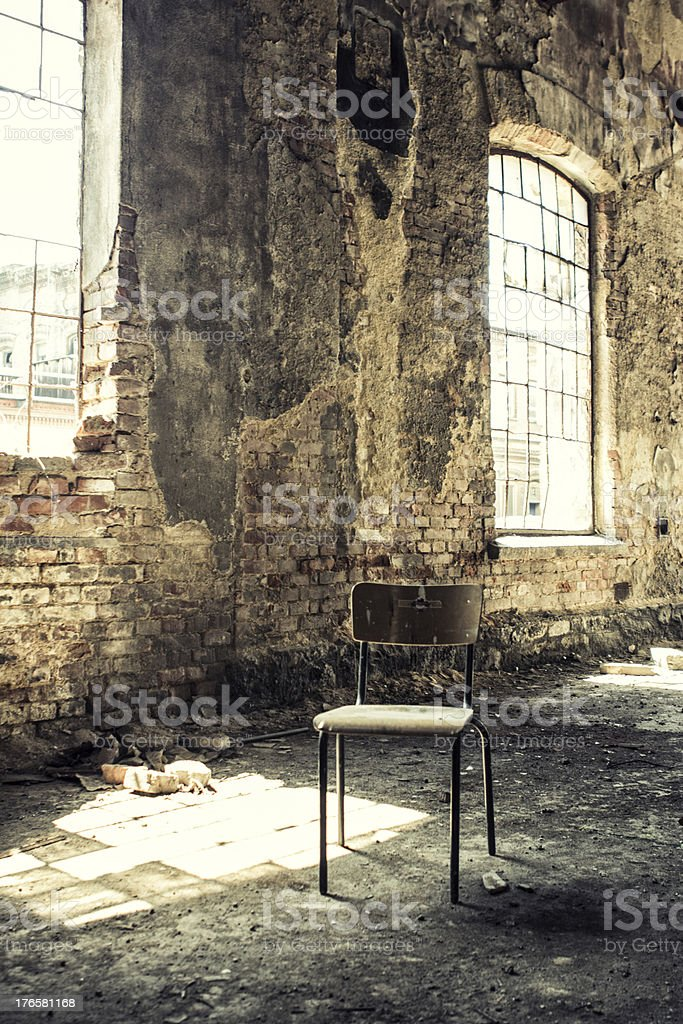 Old Chair Standing in Abandoned Building royalty-free stock photo