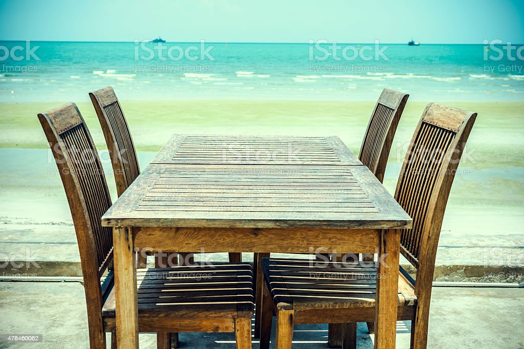 Old chairs with table and the beach royalty-free stock photo