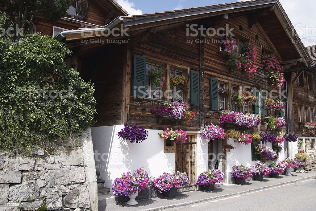 Old Chalet decoreated with flowers stock photo