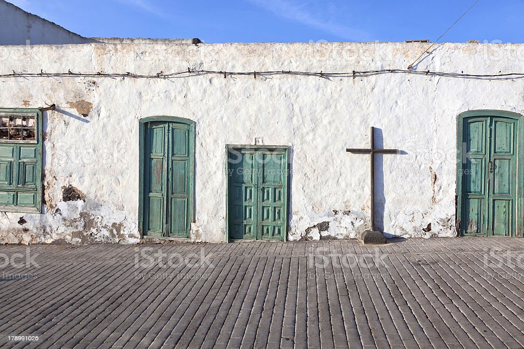 old chalked house wall with window and door royalty-free stock photo