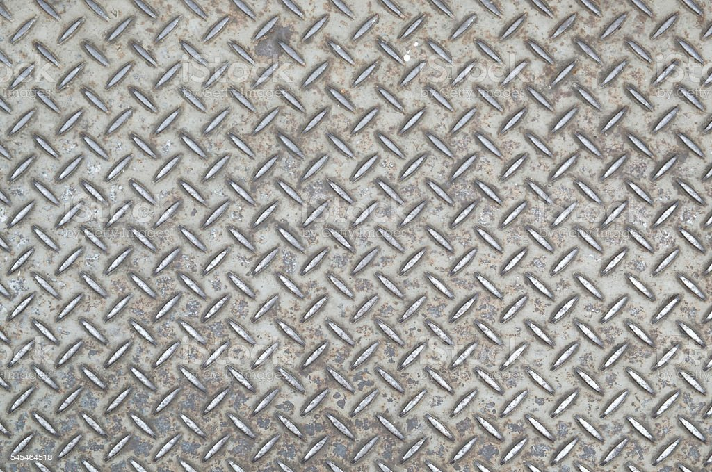 Old checkered steel plate with rusty. stock photo