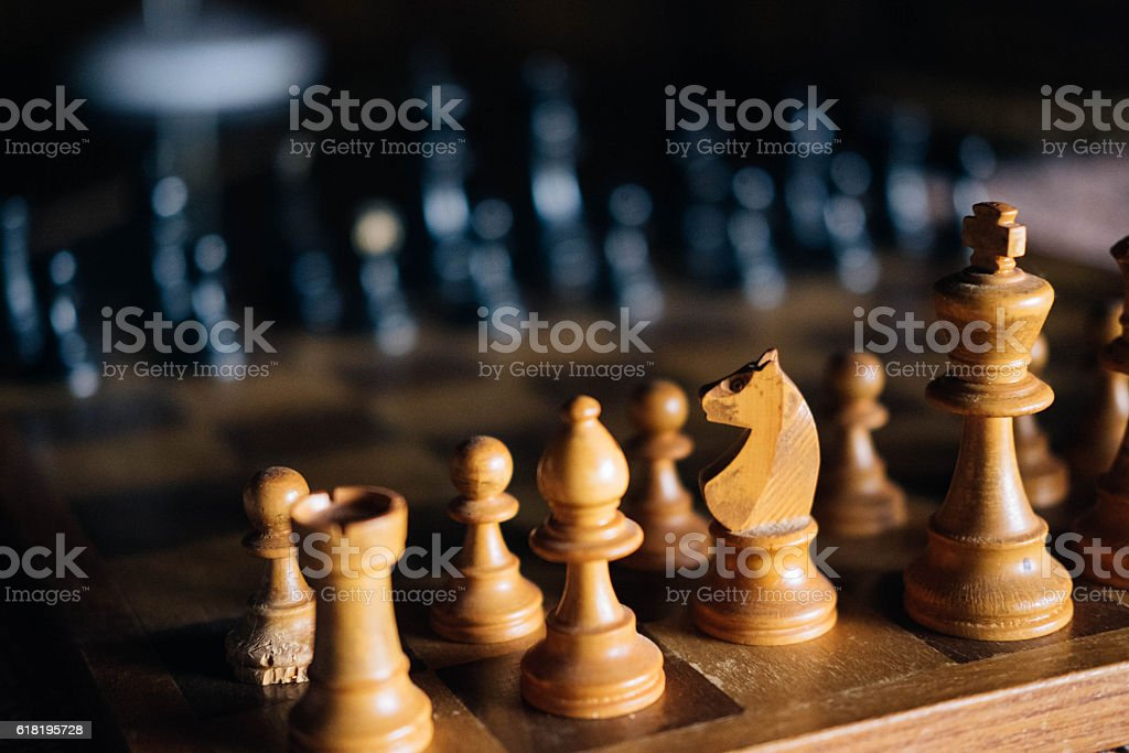Old chess board close-up stock photo