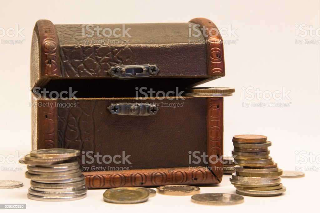 Old Chest with Coins of Different Currencies stock photo