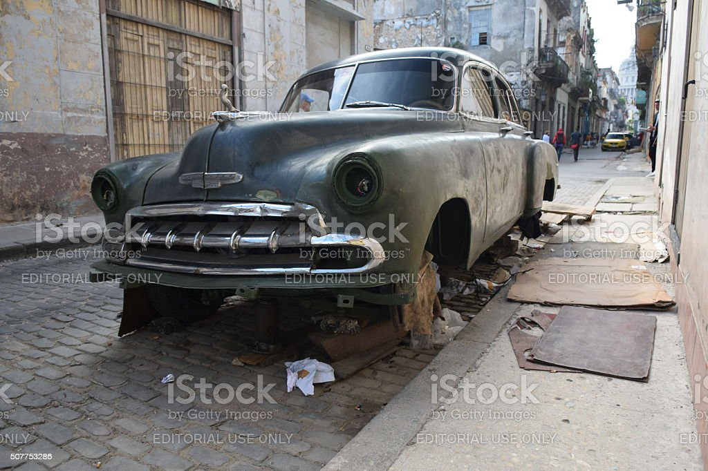 Old Chevrolet dying on the street stock photo