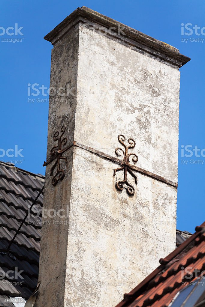 Old chimney with lily decor stock photo