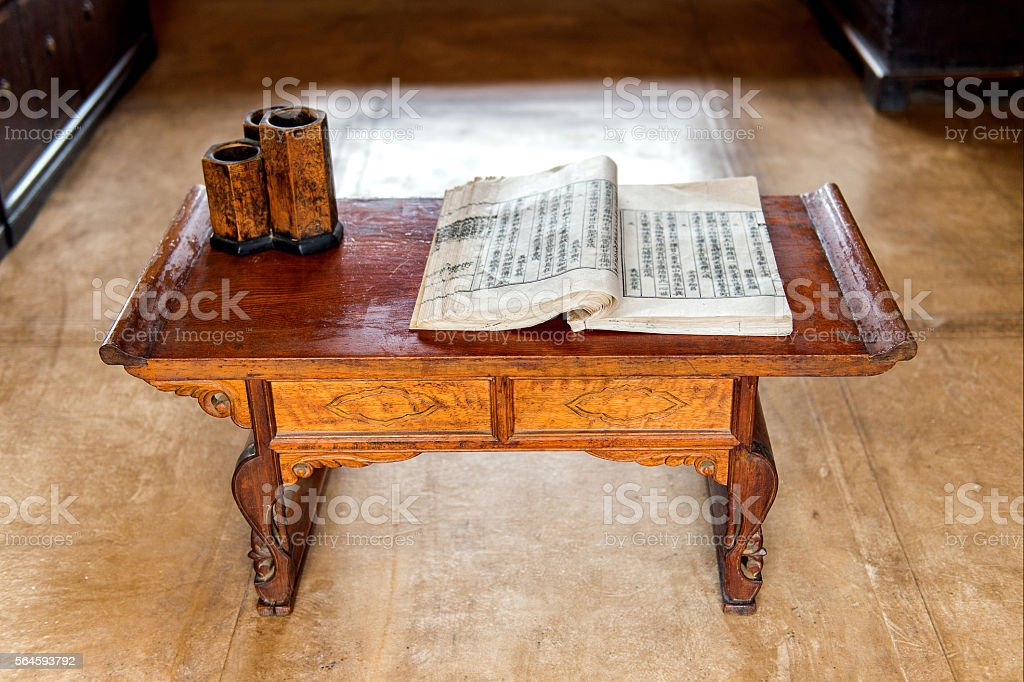 Old chinese book on wooden table. stock photo