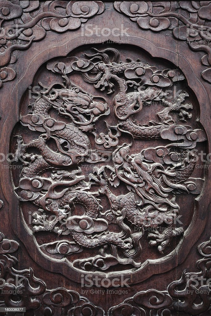 old chinese dragon woodcarving stock photo