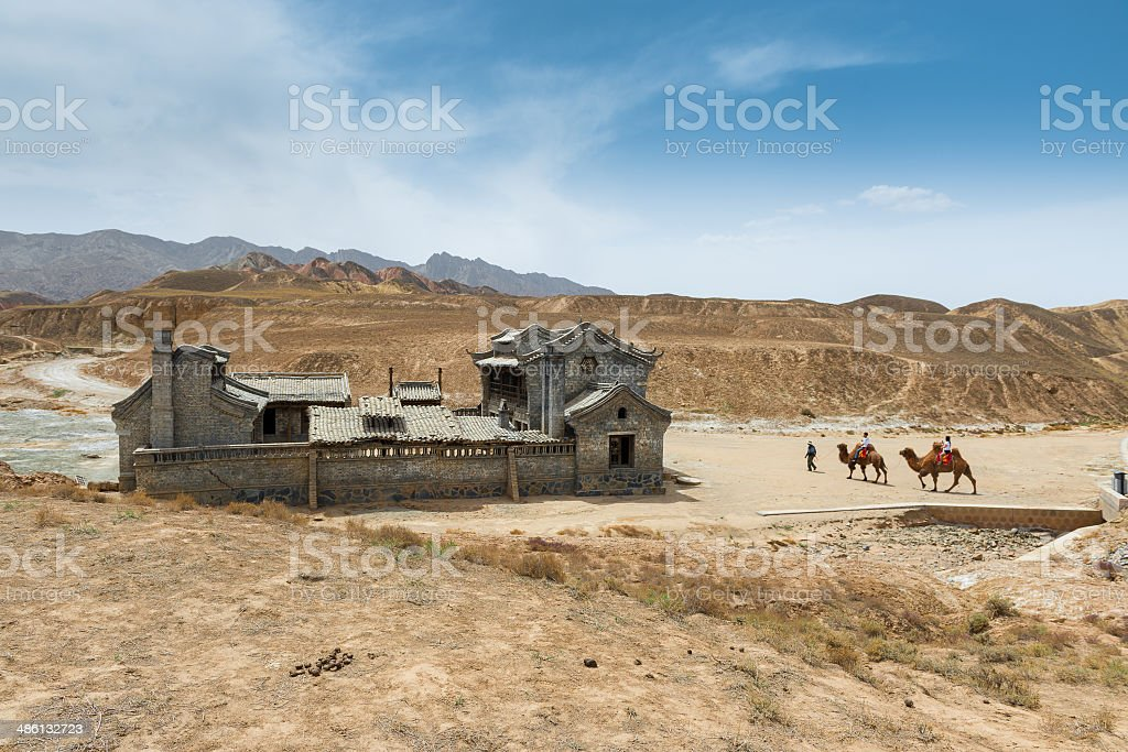 Old Chinese house at Colorful mountain Danxia Landform stock photo