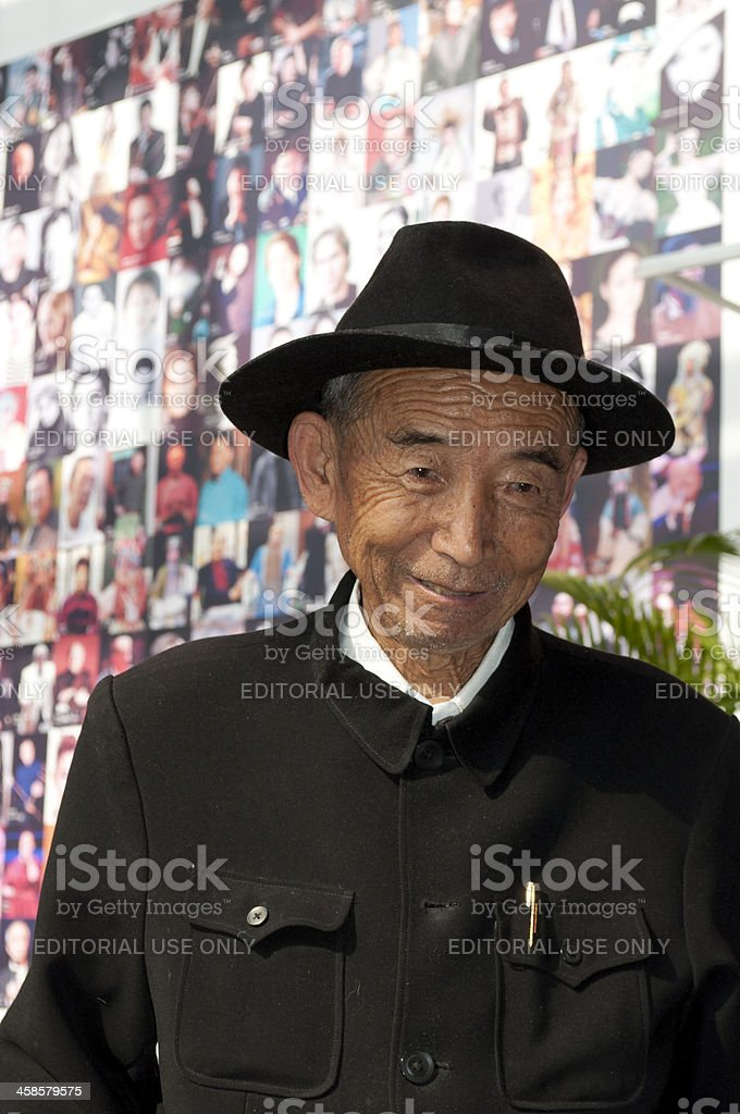 Old Chinese in front of Famous Musicians Beijing royalty-free stock photo