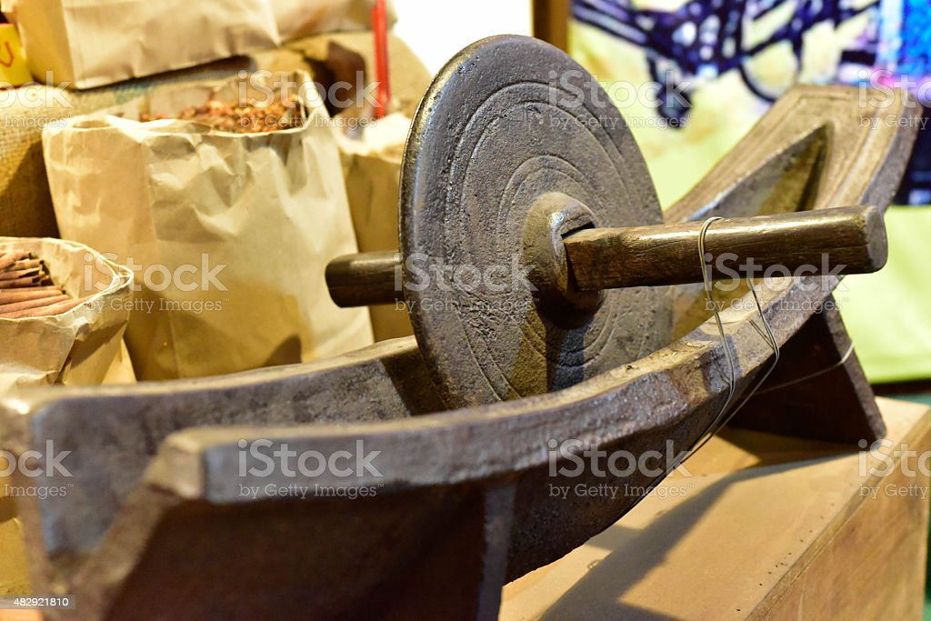 Old Chinese medicine grinder stock photo