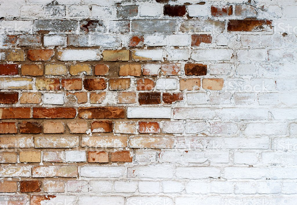 Old chipped white brick wall texture background stock photo