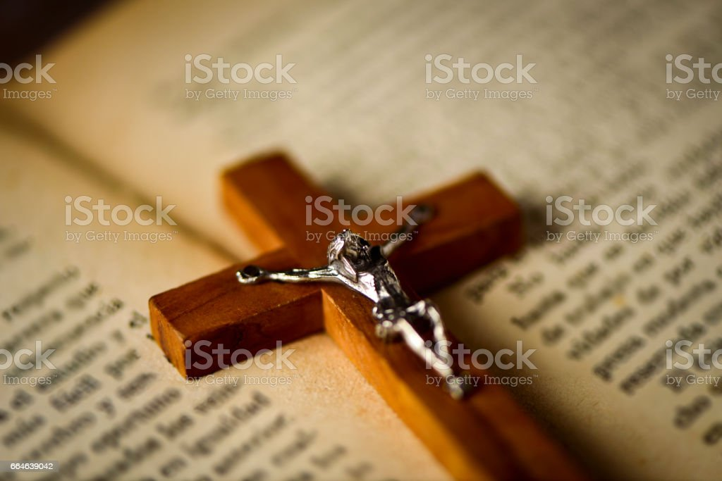 old christian crucifix on a bible stock photo
