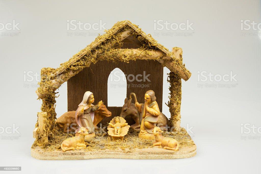 Old Christmas crib isolated on white background.Horizontal. stock photo
