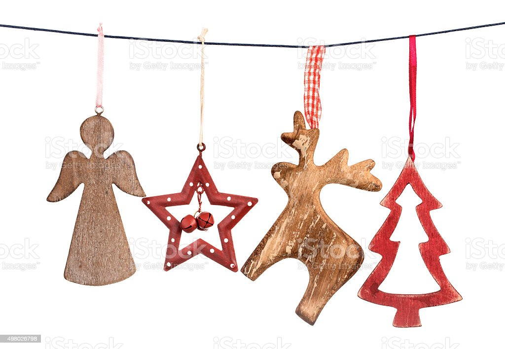 Old Christmas decorations hanging on string isolated stock photo