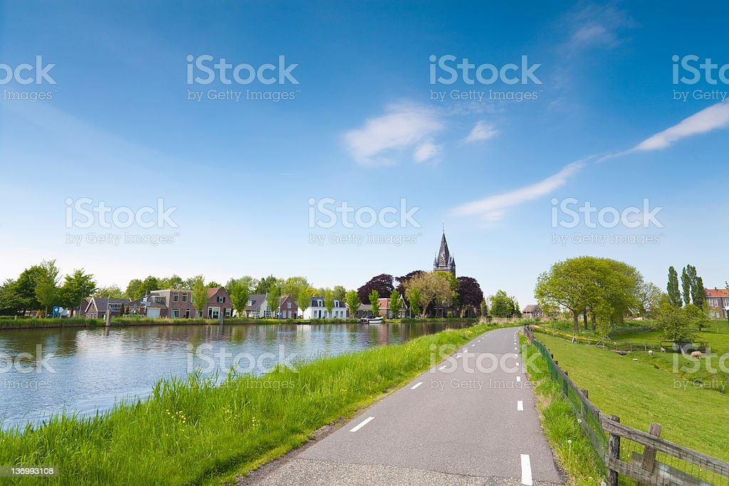 old church along amstel river, the netherlands royalty-free stock photo