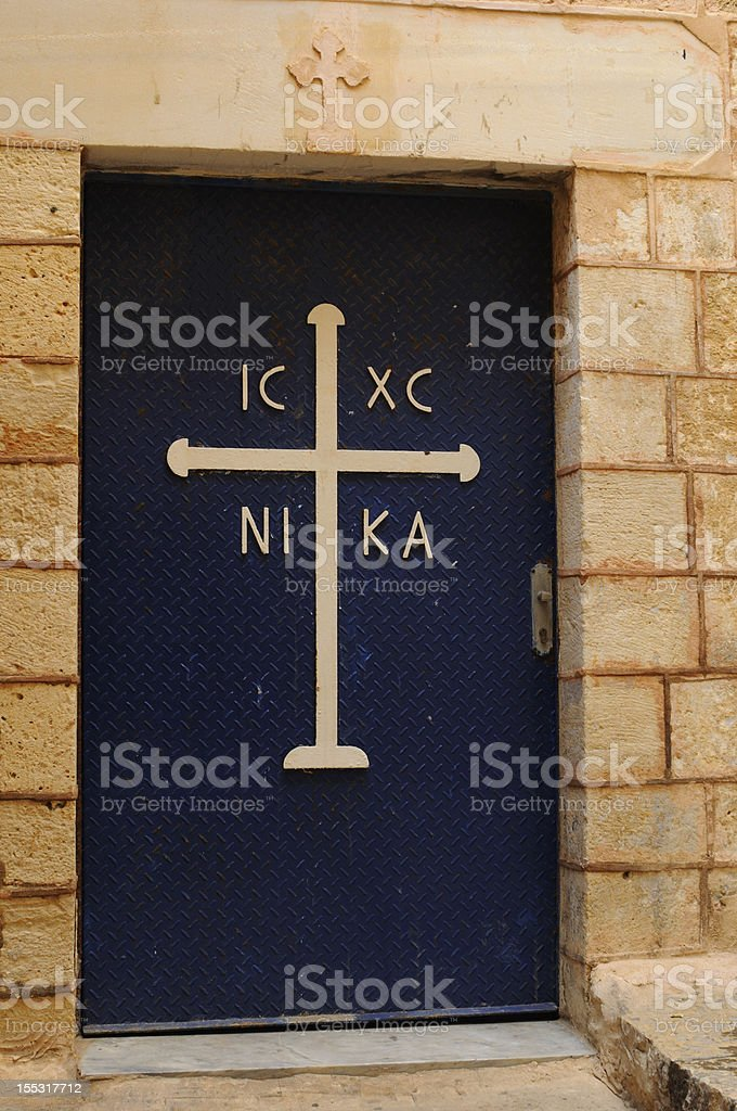 Old church blue door with cross royalty-free stock photo
