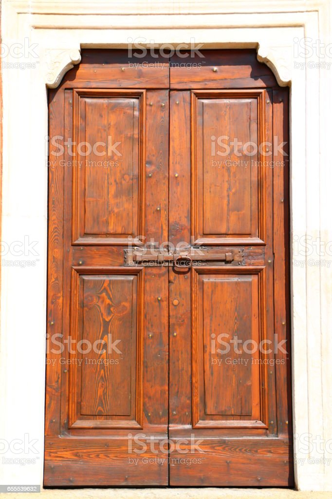 Old church door Maria Assunta in Ghiffa at Lake Maggiore, Piedmont Italy stock photo