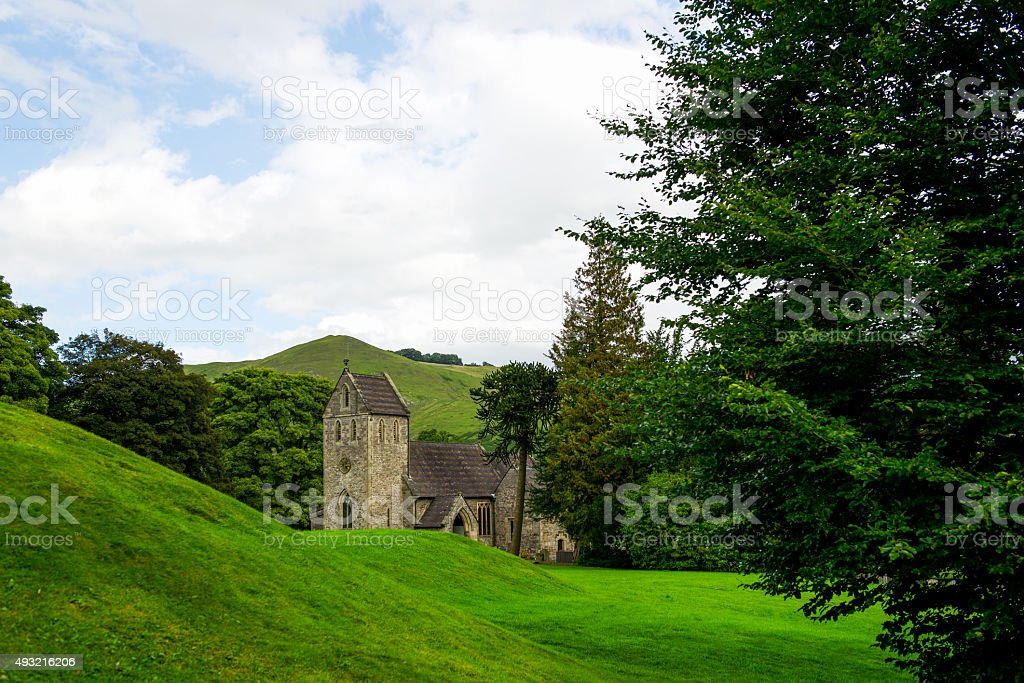 Old Church, Green Meadows and Trees in Beautiful Ilam Hall stock photo