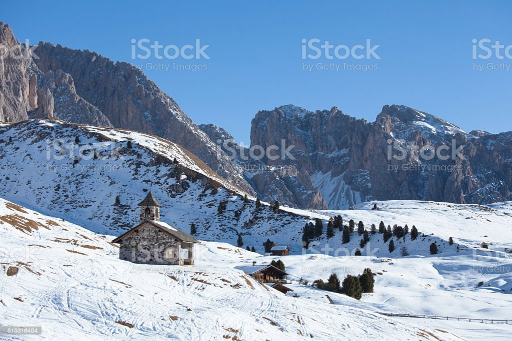Old church in Dolomites Alps on a sunny day, Italy stock photo
