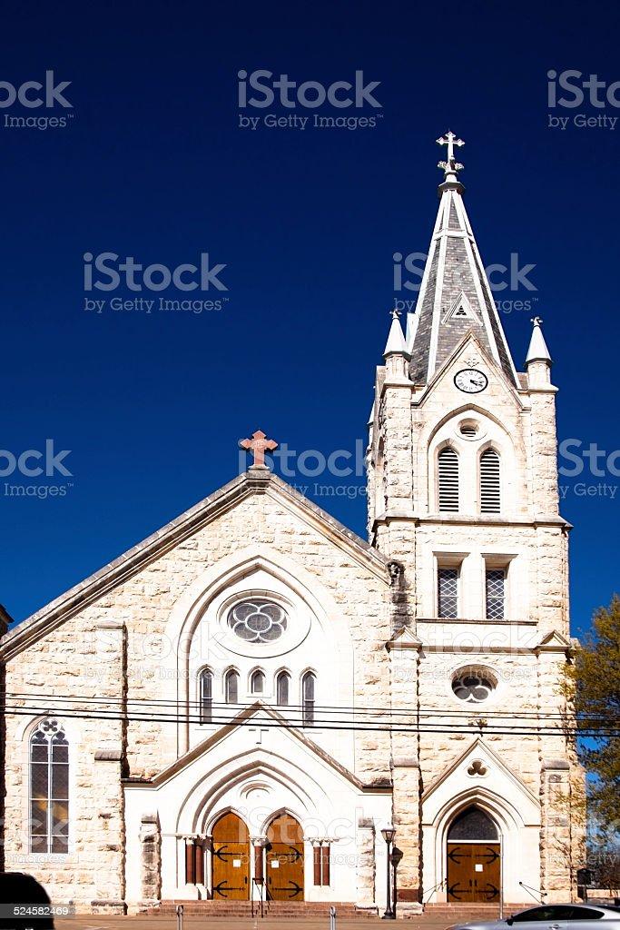Old church in Fredericksburg, Texas, USA. Spire, cross, steeple. Limestone. stock photo