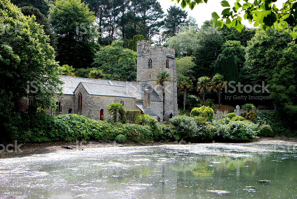 Old Church in woods by water stock photo