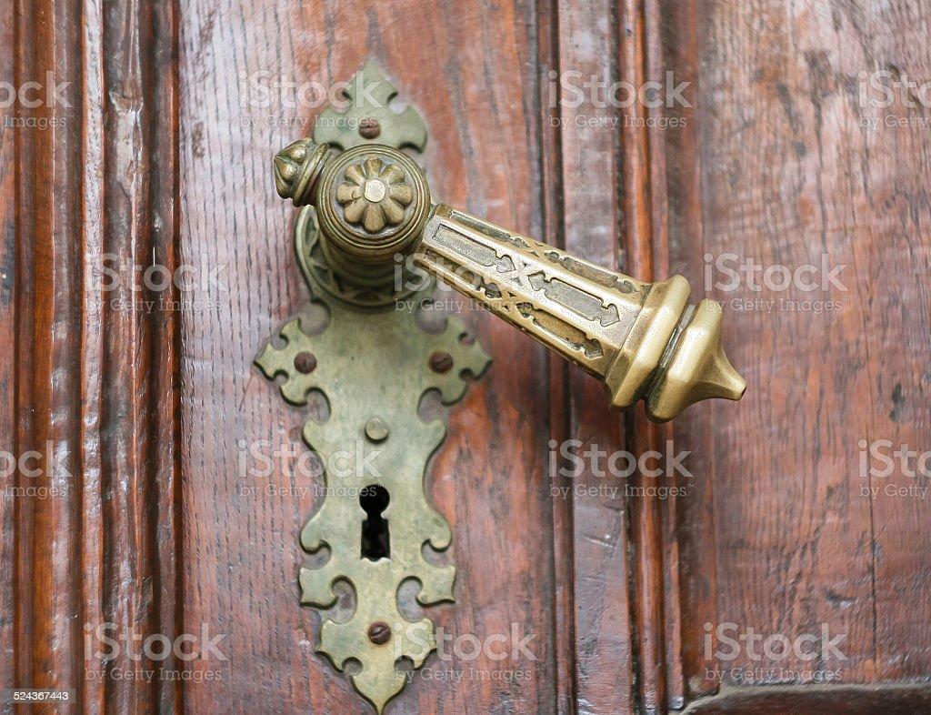 Old church metal handle on wooden door stock photo