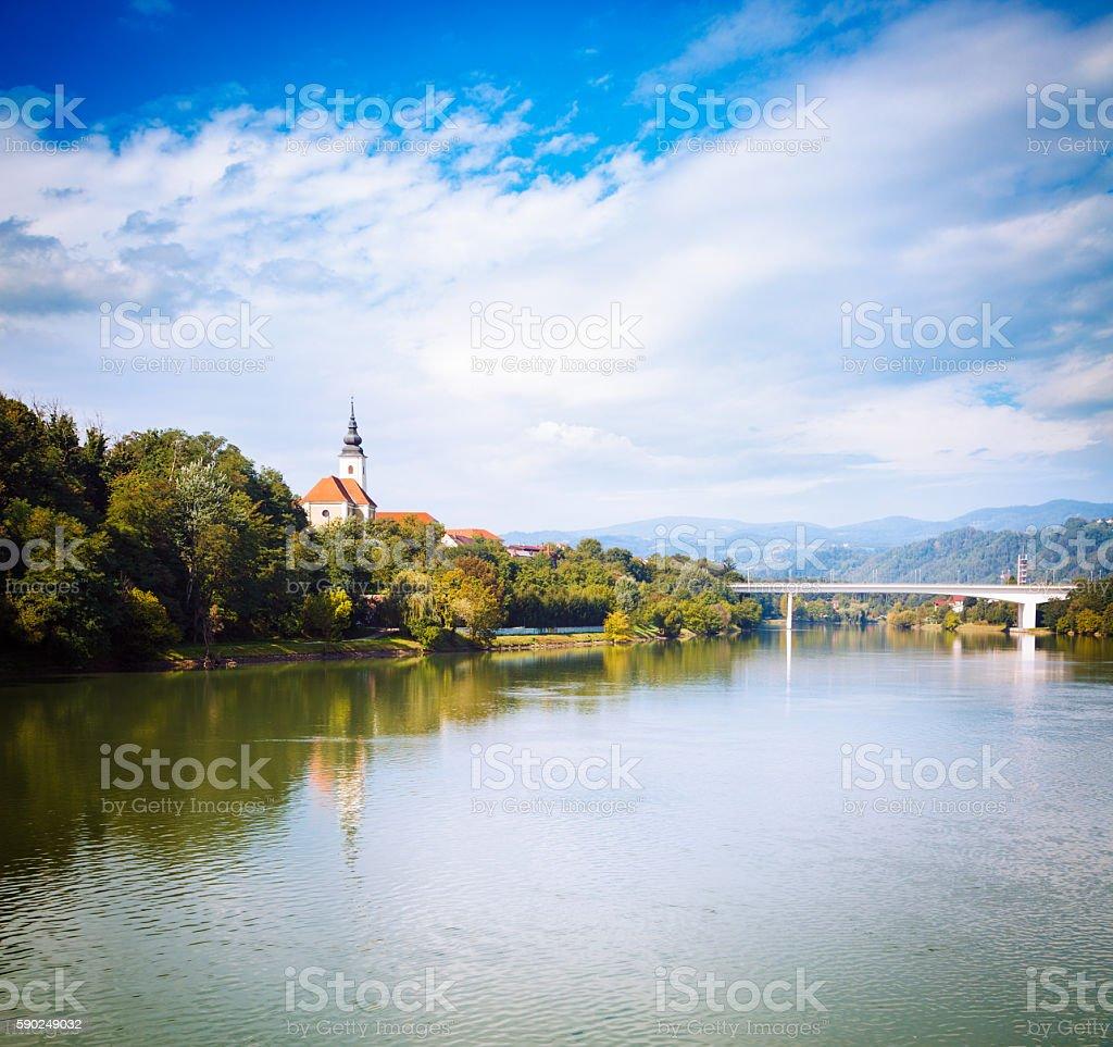 Old Church on River Bank. Slovenia, Europe. stock photo