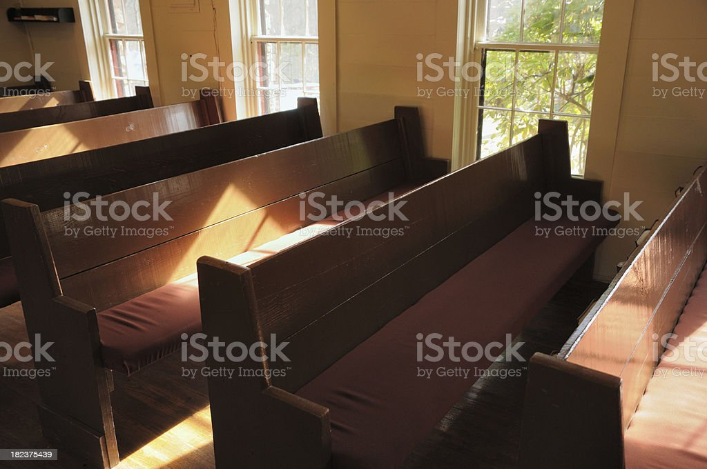 Old church pews in morning royalty-free stock photo