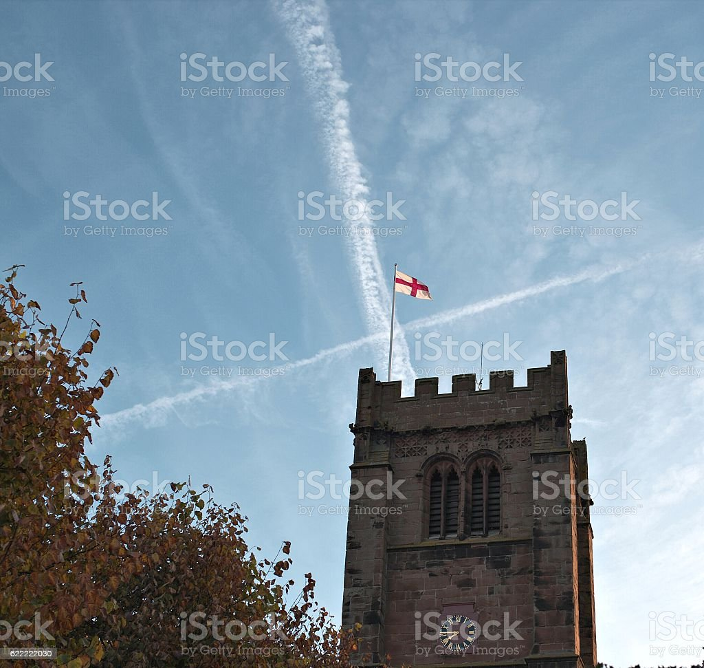 Old church tower with St George's flag on top stock photo