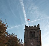 Old church tower with St George's flag on top