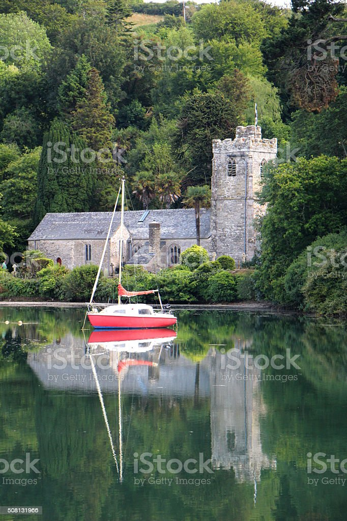 Old Church with Red Sailboat with Reflections stock photo